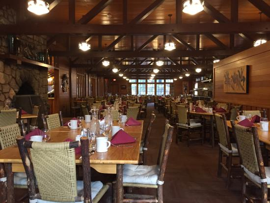 The inside of The Lodge Restaurant, with wooden lodge decor